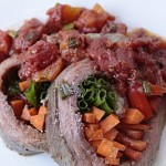 Veggie-Stuffed Flank Steak with Tequila Tomatoes